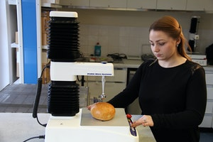 person testing bread